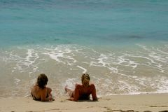 Girls on beach. Relaxing on tropical beach,West Indies Royalty Free Stock Photo