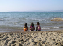 Girls at the beach. Three little girls, at the beach, in Greece Royalty Free Stock Image