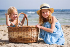 Girls on the beach with a basket Stock Photo