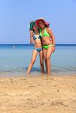 Girls on the beach Royalty Free Stock Photos