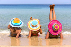 Girls on the beach Stock Images