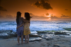 Girls beach sunset Royalty Free Stock Photos