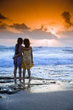 Girls beach sunset Stock Photography