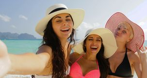 Girls On Beach Taking Selfie Photo On Cell Smart Phone, Cheerful Women In Bikini and Straw Hats On Summer Holiday stock video footage