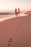 Girls on the beach Royalty Free Stock Photo