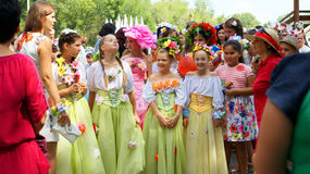 Girls in beautiful fairy costumes in bright crowd