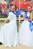 Girls in beautiful white dresses pose at open air festival White Nights Royalty Free Stock Photography