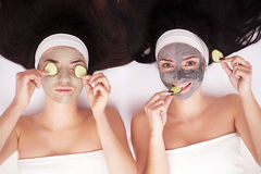 Girls in a beauty treatment with cucumber slices Royalty Free Stock Photography
