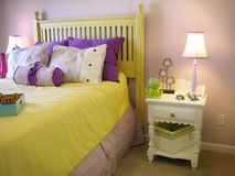 Girls bedroom. Girl's yellow and purple bedroom Stock Photography