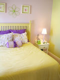 Girls bedroom. Girl's yellow and purple bedroom Royalty Free Stock Photos