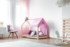 Girls bedroom with rocking horse Royalty Free Stock Images