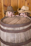 Girls behind barrel Stock Photo
