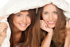 Girls below duvet Royalty Free Stock Photography