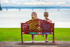 The girls on the bench Royalty Free Stock Image