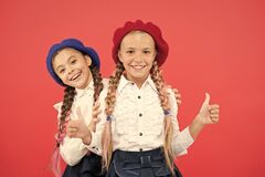 Free Girls Best Friends On Red Background. True Friends Always Stand Beside You. Friendship Means Support. Kids Long Braids Royalty Free Stock Photography - 178379047