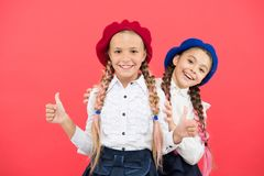 Girls best friends on red background. True friends always stand beside you. Friendship means support. Kids long braids. Hairstyle classmates friends. Cute stock images