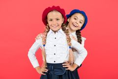Girls best friends on red background. True friends always stand beside you. Cute playful sisters schoolgirls having fun. Friendship means support. Kids long royalty free stock photos