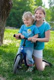 Girls and bicycle Royalty Free Stock Photography