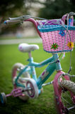 Girls bicycle. Girly bicycle for summer time sports and activities Royalty Free Stock Photography