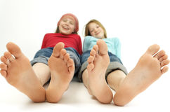 Girls with 'big feet' Royalty Free Stock Image