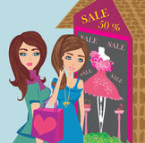 Girls on big shopping sale Stock Image