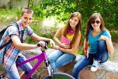 Girls and biker Royalty Free Stock Photos