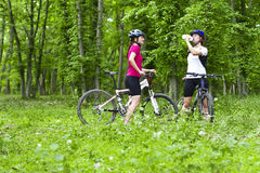 Girls  biking in the forest Royalty Free Stock Images