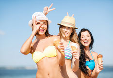 Girls in bikini with ice cream on the beach Stock Images