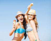 Girls in bikini with ice cream on the beach Stock Photography