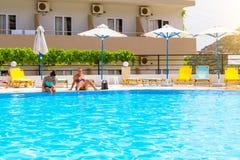 Girls in bikini poolside, hotel Atali Village, Bali Royalty Free Stock Image