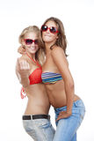 Girls in bikini tops showing come on gesture Royalty Free Stock Photography