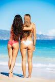 Girls in Bikinis on the Beach Royalty Free Stock Image