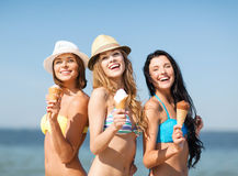 Girls in bikinis with ice cream on the beach Stock Photography