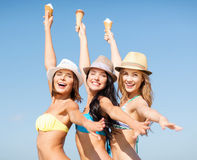 Girls in bikinis with ice cream on the beach Royalty Free Stock Photos