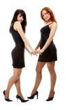 Girls in black dresses Stock Image