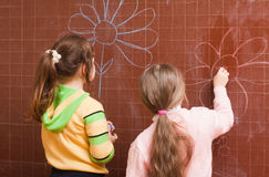 Girls at blackboard Stock Image