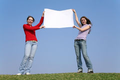 Girls with blank paper Stock Image