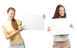 Girls with blank signboards Royalty Free Stock Photos