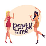 Girls, blond and black haired, in short red dresses dancing Royalty Free Stock Images