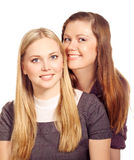 Girls  blonde and redhaired have fun Royalty Free Stock Photography