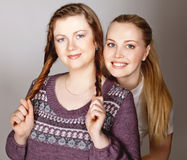 Girls  blonde and redhaired have fun Royalty Free Stock Images