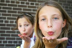 Girls blowing a kiss Royalty Free Stock Images