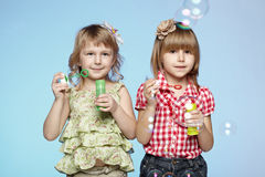 Girls blowing soap bubbles Royalty Free Stock Images