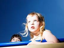 Girls on blue background Stock Photography