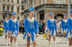 LVIV, UKRAINE - MAY 2018: Girls in blue carnival costumes at the parade in the city center Royalty Free Stock Photography