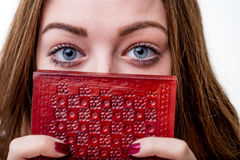 Girls'blue eyes staring at us from a book Royalty Free Stock Image