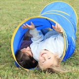 Girls in blue kids tunnel Royalty Free Stock Photos
