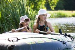 Girls on boat Stock Photo