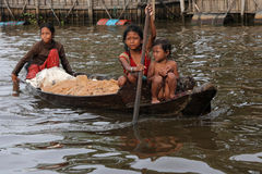 Girls on boat in the floating village of Inle Lake Royalty Free Stock Images