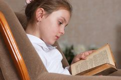 Girls with book at brick wall Stock Image